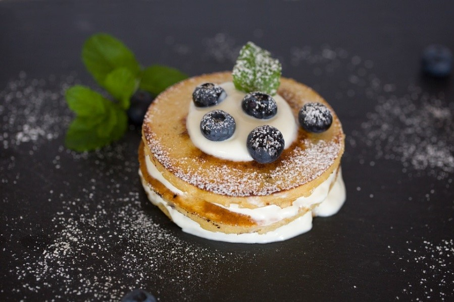 American Style pancakes with cream and blueberries